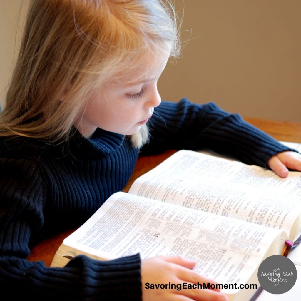 girl with Bible - Bible verses for kids to memorize