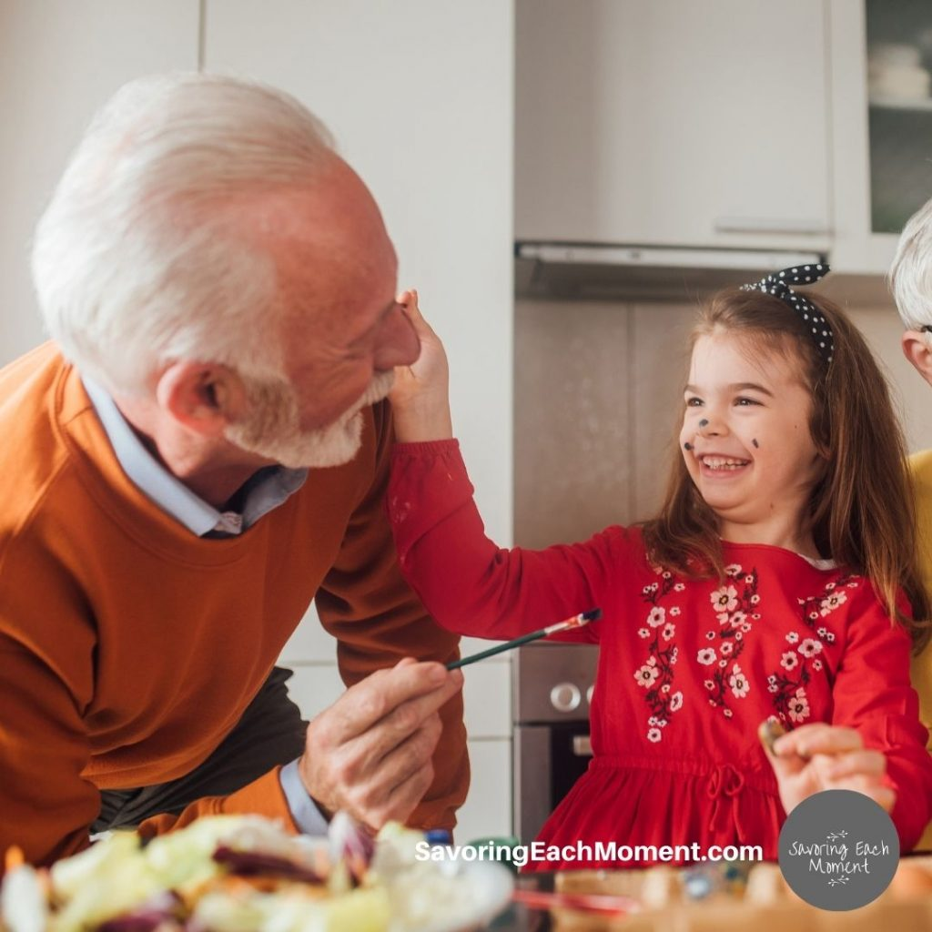 Little girl and grandpa playing - easy community service projects and deas for kids