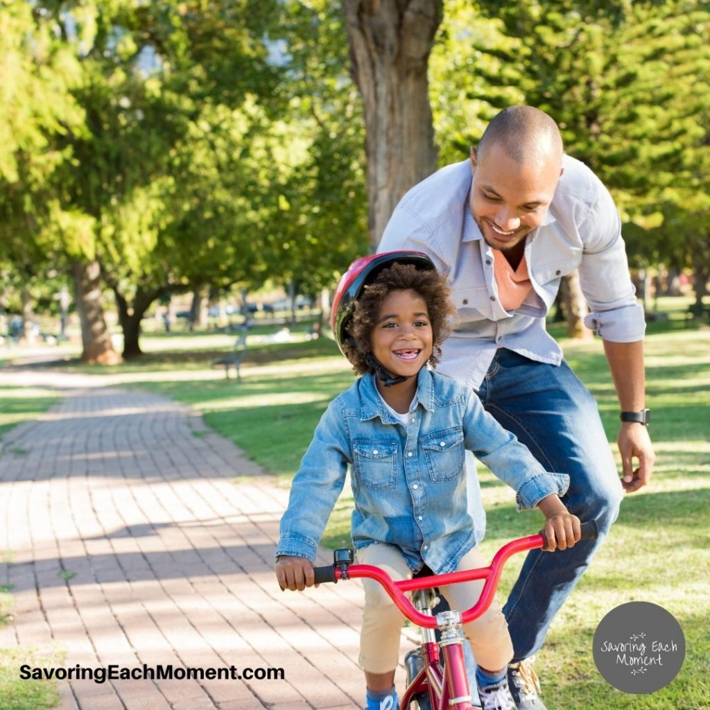 dad with girl on bike - words of encouragement